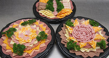 Collage of Meat and Cheese Party Trays